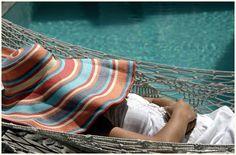 Siesta by the villa pool in Santorini..