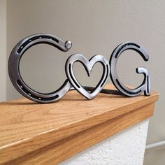Hey, I found this really awesome Etsy listing at https://www.etsy.com/listing/173688714/personalized-horseshoe-heart-couple-sign
