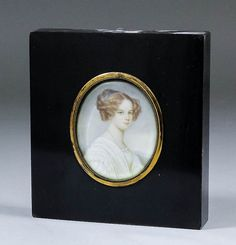 """Moritz Michael Daffinger (1790-1849) - Miniature shoulder length portrait of a young woman wearing a white dress, her brown hair in ringlets and tied with a blue ribbon, sky and landscape to background, thought to be on ivory, oval, 2.675ins x 2.25ins, signed """"Daffinger"""", in ebonised frame and glazed"""