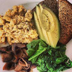 Superfood breakfast! Quinoa scrambled eggs with kale, coconut mushrooms, avocado and Ezekiel bread #emmalaurenfood