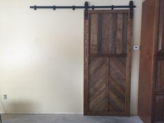 Sliding barn door made from pallets