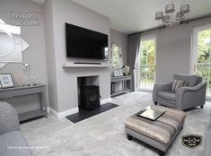 Carpet Living Room Grey lounge with grey sofas and grey carpet in 11 Grey Carpet Living Room, Grey Carpet Bedroom, Living Room With Fireplace, Home Living Room, Living Room Designs, Living Room Decor With Grey Sofa, Charcoal Sofa Living Room, Cottage Fireplace, Silver Grey Carpet