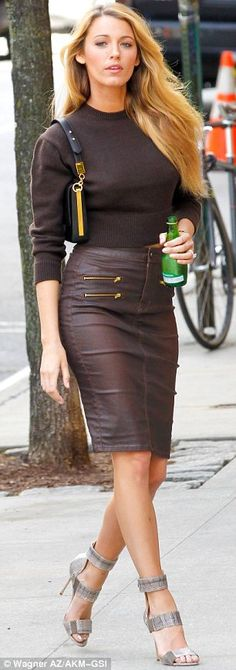 Gently does it: Blake expertly strode around the Big Apple set despite the fact she was in sky high silver sandals