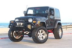 Jeep Wrangler Rubicon - with a lift and big fat tires! Prefer a soft top, but won't complain about a hard top.