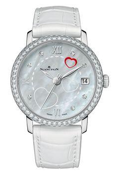 O relógio Blancpain San Valentin 2014 conta com um coração vermelho e outros dois brancos gravados no dial de madrepérola. Com uma fila de diamantes no bisel, sua tiragem é limitada a 99 unidades.