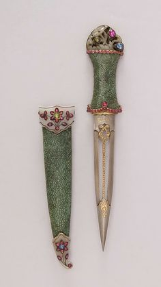18th century Indian dagger with sheath, made with steel, shark-skin, jade, gold, ruby, emerald, sapphire and silver.