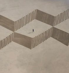 This artist, Jim Denevan, creates simple repetition of shapes in the sand. Simply beautiful temporary art.