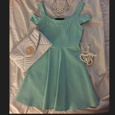 🎉HP🎉 Foreign Exchange teal skater dress Foreign exchange teal skater dress with shoulder straps. Tag was taken off but item was never worn. Great quality dress and unique color. Foreign Exchange Dresses
