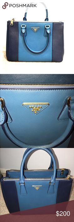 Prada two tone bag Prada bag. Unique two tone blue shades. Only used for a week though there are two Little black dots on handle not sure what they are. They are barely noticeable. Lots of room, tons of pockets. When I brought it to Prada to compare I could not tell the difference. You won't either. I bought it while on my honeymoon out of the country. Dust bag included. Prada Bags Totes
