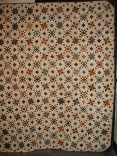 Two different pieced star patterns in this mid 19th century intricately pieced quilt