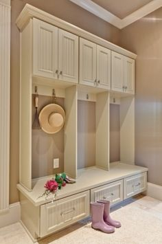 Love the idea for closed drawers for the shoes instead of open cubbies!!      traditional entry by Teri Turan