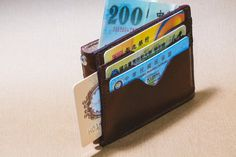 Check out this item in my Etsy shop https://www.etsy.com/listing/208157481/super-minimalist-wallet-8-card-slots-1