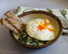 A great brunch or dinner recipe for Fried Eggs with Creamy Spinach and Toast Soldiers, and a tale of uncharacteristic spontaneity in Spain.