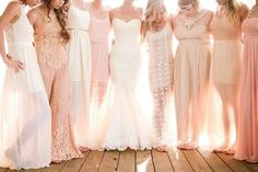 bridal party in blush and cream bridesmaid dresses