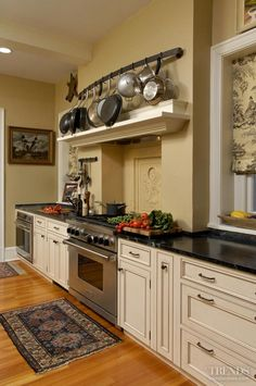 Gather together -For a kitchen to be truly the heart of the home it must not only reflect the lifestyle of the family, but also complement the overall interior decor. In an older house, says Jennifer Gilmer, CKD, this means hiding contemporary functionality behind traditional materials and detailing.