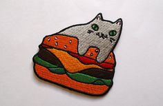 Burger cat embroidered patch - Iron on patch  Inspired by my Cats and fries print, I decided to redraw my illustration to be made into these super cute embroidered patches! The patch measures 7cm wide and high, made with vivid coloured threads. Can be ironed or sewn onto place on your favourite jacket, jeans, jumper, hat or anywhere else you can think of. Show the world how much you love burgers and CATS, the perfect combination.  This is the only place you can buy the genuine burger cat…