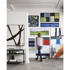 Crate and Barrel is excited to present ARTWORKS, a limited-time release of 15 modernist framed canvas prints curated with a decorator's eye. Bold with color that's easy to live with and scaled to make a big impression, these prints can transform a room in an instant, at a surprisingly affordable price.<br /><br />Expressive strokes of dark brown interact as a compelling, organic composition that recalls the bold impact of Abstract Expressionism. Presented in a slim, black wood frame, this…