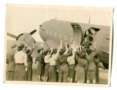 Original Official British Photograph of W.A.A.F Greet Returned Prisoners of War