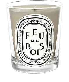 Invest in this Diptyque candle for a unique scent of wood within the home.