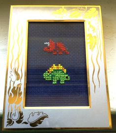Post with 166 views. I bought a tiny frame at a thrift store so I made some tiny dinosaurs to go in it! Tiny Dinosaur, Tiny Cross Stitch, Thrifting, To Go, Dinosaurs, Frame, Stuff To Buy, Store, Crossstitch