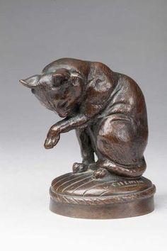 """Victor Chemin (1825-1901)."""" Chat se léchant """".Bronze à patine brune. Signé. H. 10 cm."""