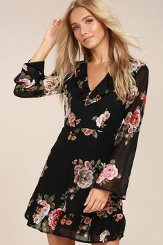 For date night or the big dance, the Alive with Artistry Black Floral Print Long Sleeve Dress is a perfect fit! Woven poly, with a pink, red, orange, green and white floral print, shapes a darted bodice, V-neckline with ruffled trim, and long flaring sleeves. Fitted waist and sheath skirt with ruffled hem. Hidden back zipper.
