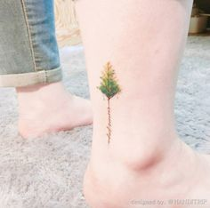 Watercolor tree tattoo on ankle by Hand Trip