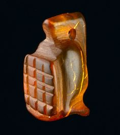 Amber amulet in the shape of gladiator's helmet. Ancient Rome, found in London, about 1st-2nd century AD A tiny amber amulet shaped like a gladiator's helmet has been discovered in the Walbrook area by Museum of London Archaeology (MOLA).Measuring...