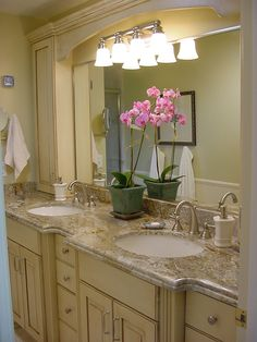 Bathroom Remodel: cream cabinets; stone countertops; jack and jill sinks; goose neck or curved faucets; large mirror