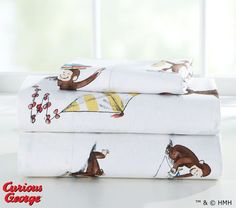Adorable organic cotton sheets are the perfect starting point for a Curious George bedroom.