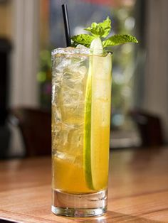Minted Memory  1 oz. Bombay Gin  1 oz. Pimm's No. 1  1/2 oz. lemon juice  1 oz. minted vinegar syrup  Small pinch of fresh mint  Splash of soda water    Muddle mint, lemon, and syrup lightly in mixing glass. Add spirits and fill with ice. Shake and strain into ice-filled collins glass. Garnish with cucumber and mint.