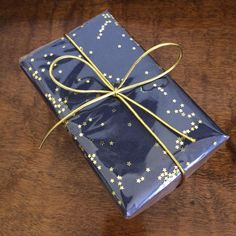 Navy wrapping paper (or any colour you like), stars & cellophane ⭐️