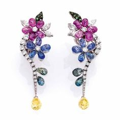 Flower earrings in white gold with coloured stones by Staurino Fratelli.
