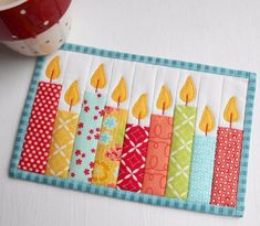 candles mug rug