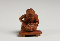 Netsuke of Man Cutting Pumpkin, late 19th century. Japan. The Metropolitan Museum of Art, New York.  Gift of Mrs. Russell Sage, 1910 (10.211.1827).