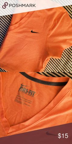 Nike Dri Fit Tee Light orange color, v neck, dri fit. Perfect condition. Nike Tops Tees - Short Sleeve