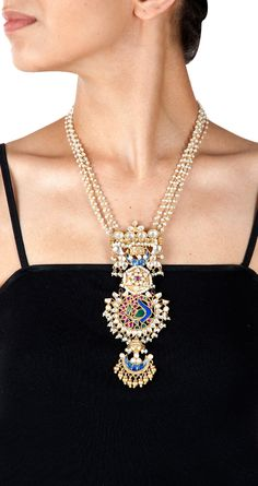Peacock motif pearl necklace by AMRAPALI. http://www.perniaspopupshop.com/designers-1/amrapali