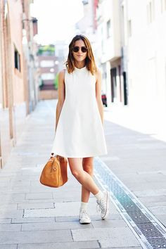 Dans Vogue.  Ever in need of advice on how to wear a white dress? Bookmark this page.