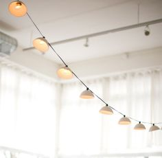 Pleated String Lights MADE TO ORDER by PigeonToeCeramics on Etsy / A set of ten unglazed porcelain shades with a tiered surface cast ultra thin for translucency strung up on an indoor/outdoor 11 green cord with 12 bulb spacing. String Lights Outdoor, Outdoor Lighting, String Lighting, Hanging Lights, Light String, Overhead Lighting, Exterior Lighting, Modern Lighting, Lighting Design