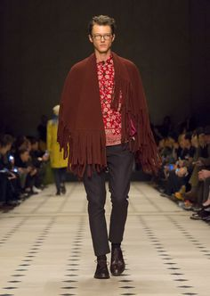 Burberry Menswear A/W15 Show. A cotton utility jacket with an ornamental floral print worn under a burgundy felted wool cashmere poncho