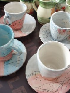 French coffee mugs by Sylvie Duriez. Each cup and saucer is unique, with pastel washes and etchings that look like dreamy landscapes. #coffee #tea #France