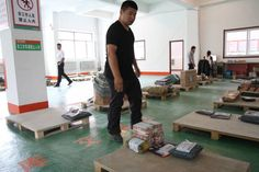2015-8-30 - Packages at Cainiao's distribution center in Mingshui, northeastern China, will travel across bumpy country roads...