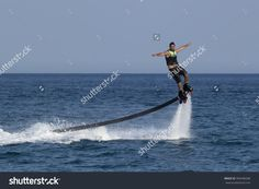 Camyuva, Kemer, Turkey - July 12, 2015: Unidentified Turkish Man Hovered Above The Water. Extreme Water Sports Are Increasingly Popular On The Beaches Of Turkey Стоковые фотографии 396448348 : Shutterstock