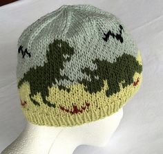 """Boys or girls Dinosaurs Hat Knitting Pattern is sized for ages 4 - 12, with a finished circumference of 20-21"""" In PDF format. Also included are instructions for sizing down a bit for younger little ones."""