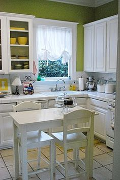 green kitchen. love the white cabinets/table!