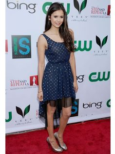 The dress and Nina ♥ Nina Dobrev looks pretty in polka-dots. Her high-low dress would pair perfectly with a blazer!