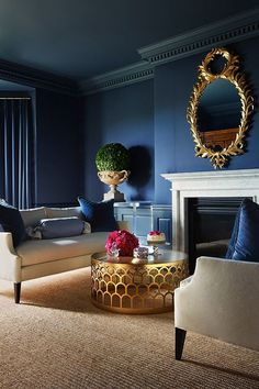 A very roman room , love the ghost table and laurel reef mirror , blue and gold are very striking