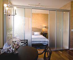 studio bedroom. glass door for separation.