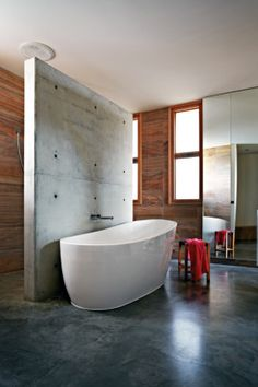 Bathroom A large tub to soak in with smooth and calming concrete underfoot. Via www.homelife.com.au
