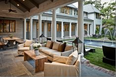 Love this furniture, lamps, tile. French doors, columns, pool, loungers